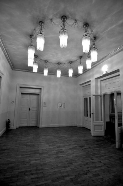 Mirrored Room with a giant chandelier on the first floor