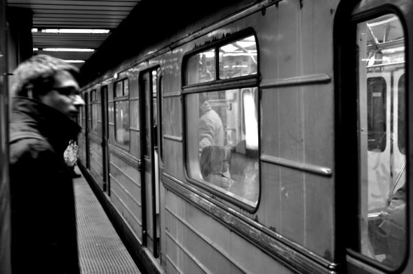 Man waiting for the Metro at the Kálvin Tér Station in Budapest, Hungary