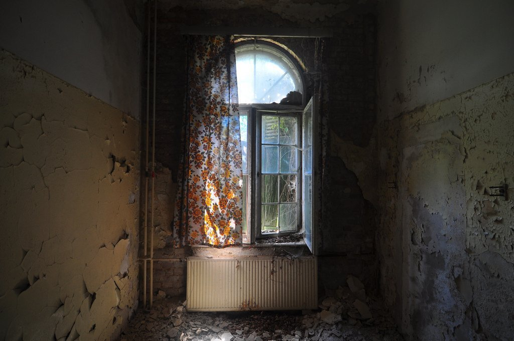 an abandoned room with orange flower curtains - Digital ...