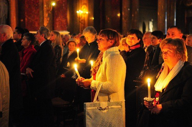 Hungarian Women holding candles during Easter Mass