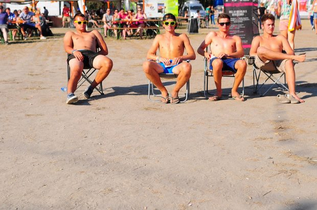 four guys relaxing on chairs at the Sziget Festival in Budapest