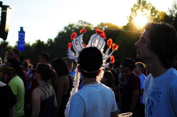 A Festivalgoer wearing an Indian Headdress at the Sziget Festival