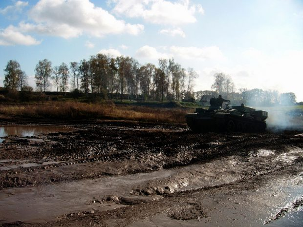 T55 driving through the mud