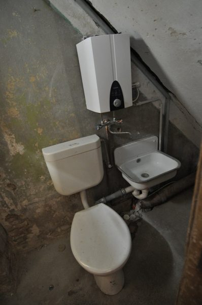 A midfloor level shared Toilet in a 19th Centruy German Apartment House