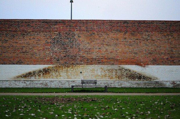 park bench by the prison wall