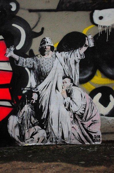 graffiti jesus street art next to the abandoned church in lyon, france