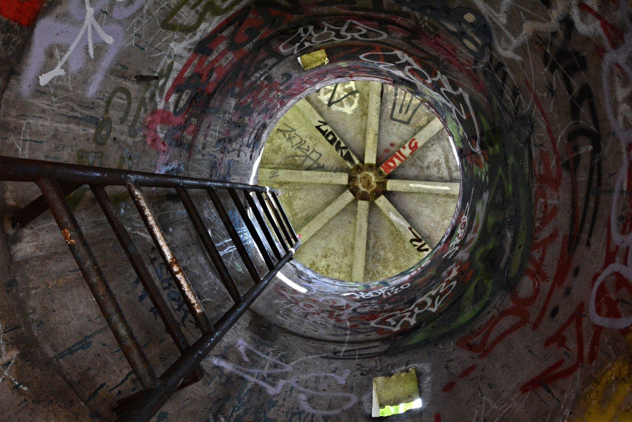 lader inside abandoned east berlin watchtower Postenturm Neumagener Strasse Liebermannstrasse