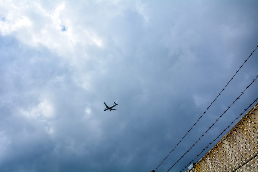 airplane flying over tegel txl berlin airport germany