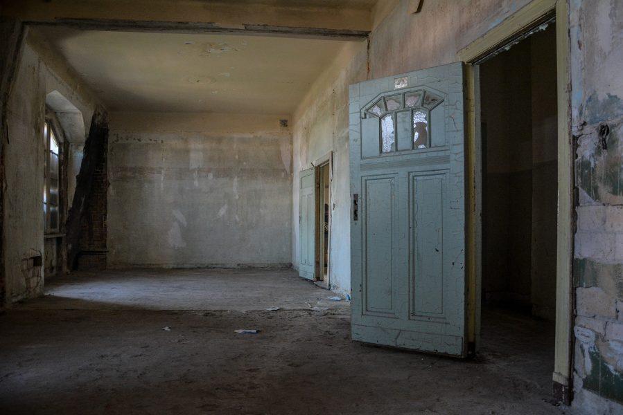 blue door top floor hallway v